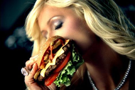 Paris hilton bites into a carl s jr burger