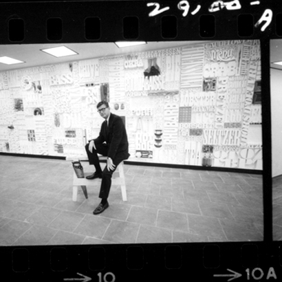 Lou Dorfsman sits in front of the completed Gastrotypographicalassemblage.